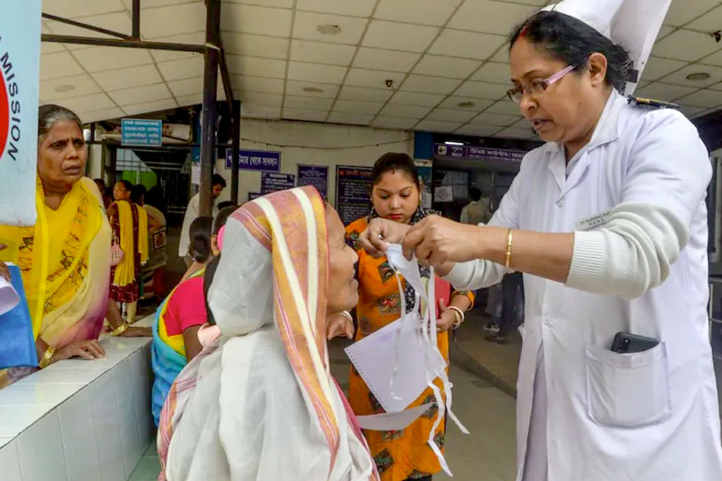 A nurse explains about the virus during a Covid-19 awareness event at a government hospital in Siliguri, Bengal.