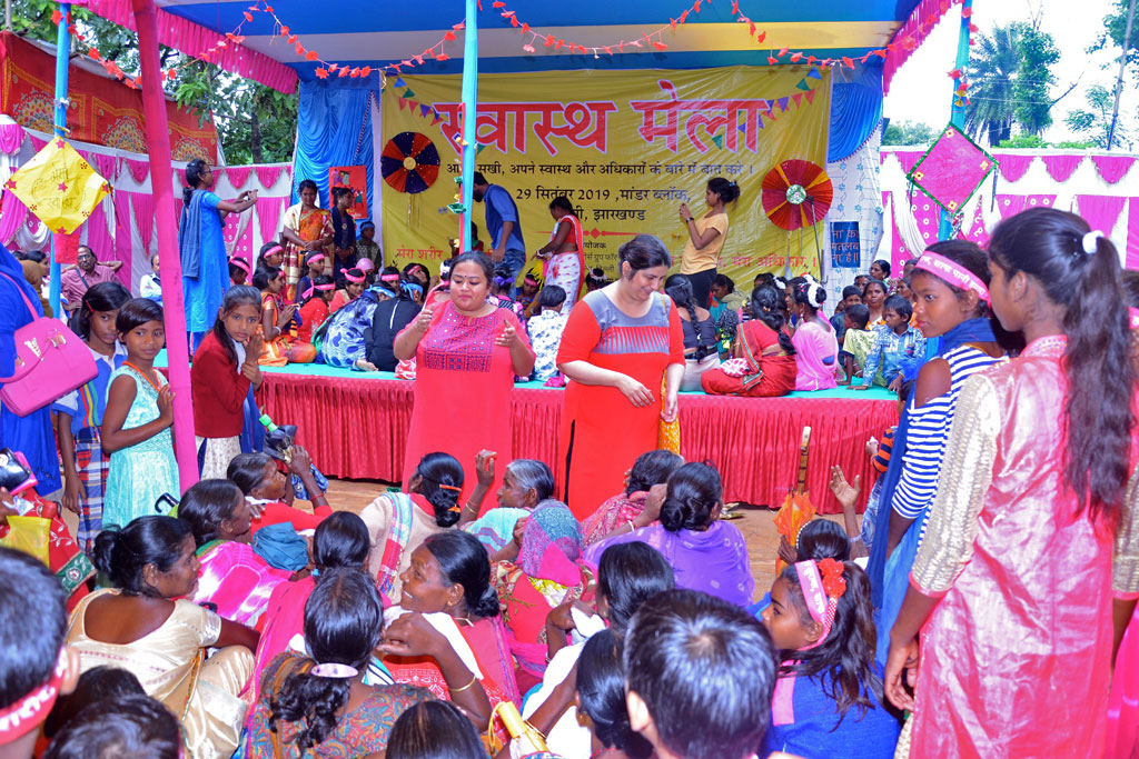 Engaging with women and girls with slogans during the Health Mela.